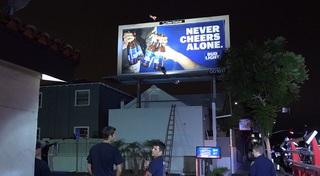 Man climbs up Mission Hills billboard