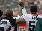 Eagles player gets support during anthem protest