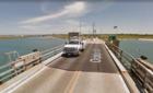 Driver forced to gun engine, jump rising bridge