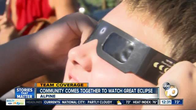 Alpine community members come together to view eclipse