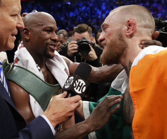 Undercard fights start for Mayweather-McGregor — The Latest