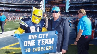 Chargers fan nearly booted from game over mask