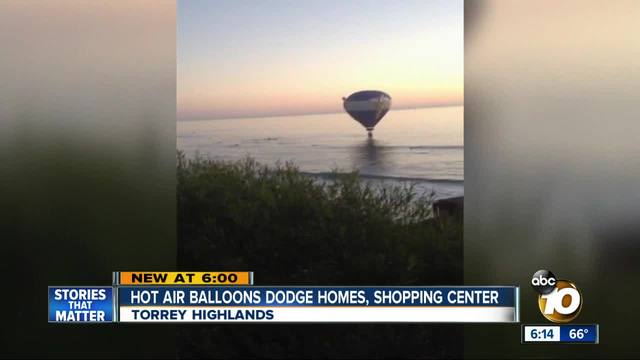 Hot air balloons dodge homes- shopping center