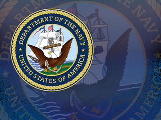 Former Navy officers charged in bribery scandal