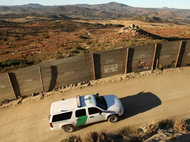 Border Patrol Vehicle Patrols Wall