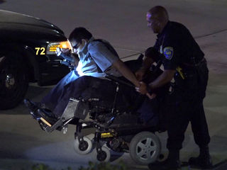 Police chase wheelchair-bound robbery suspect