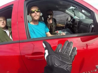Caught on camera: Driver points gun at biker