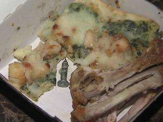 Teen eating leftovers bites into screw