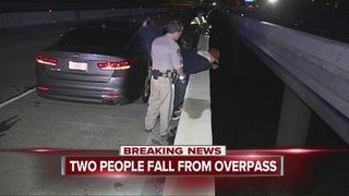 Men fall off bridge while urinating over rail