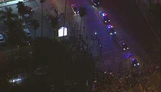 Protesters fill streets, surround cars in LA