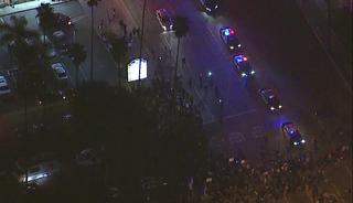 Protesters fill streets, surround cars in LA