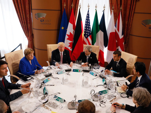 G7 leaders divided on climate change, closer on trade issues
