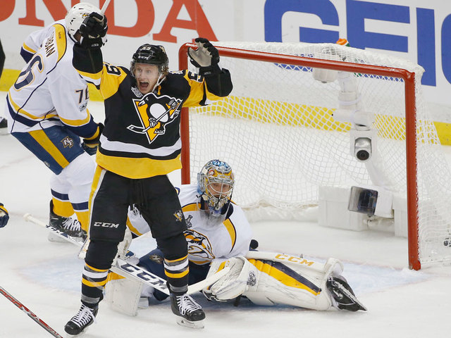 Pittsburgh Penguins' Jake Guentzel, front, celebrates a goal by teammate  Evgeni Malkin in front of Nashville Predators goalie Pekka Rinne during the  first ...