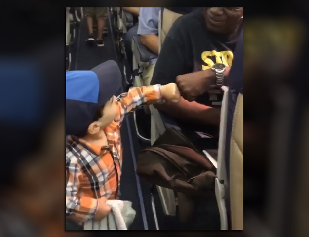 Boy makes friendly skies friendlier one fist bump at a time