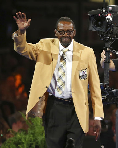 Kenny Easley waves to the crowd after receiving his gold jacket during the  Pro Football Hall of Fame dinner at Canton Memorial Civic Center in Canton b9011b078