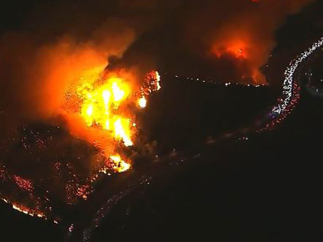Creek fire shuts down portion of 210 Freeway, traffic being diverted