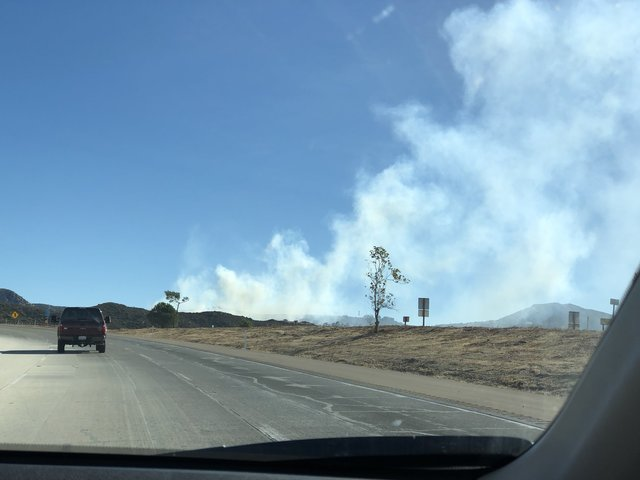 Crews battling vegetation fire along Interstate 15 in Bonsall