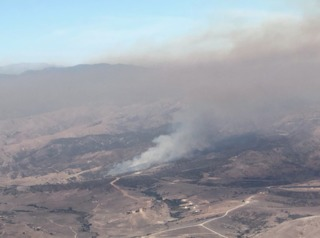 Smoke rises above Camp Pendleton due to fire