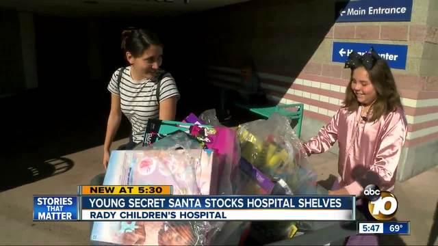 Young Secret Santa stocks hospital shelves