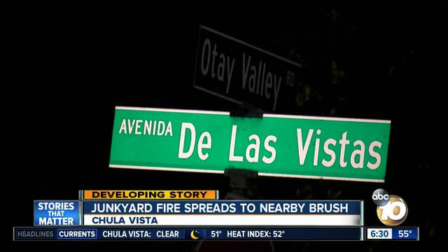 Junkyard fire spreads to nearby brush in Chula Vista