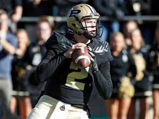 Purdue QB leads team to bowl win with torn ACL