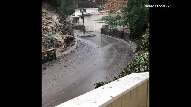 Caught on camera: Driver rides out mudslide