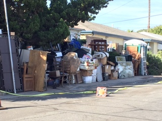 Crews begin clearing College Area hoarding house