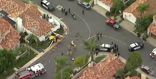 Helicopter with 4 people on board crashes into home