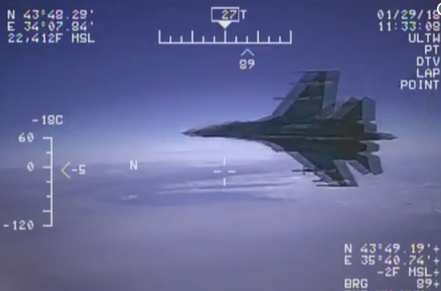 US Navy video shows Russian jet's close encounter with US surveillance plane