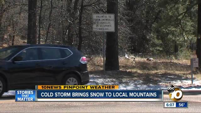 Cold storm brings snow to local mountains