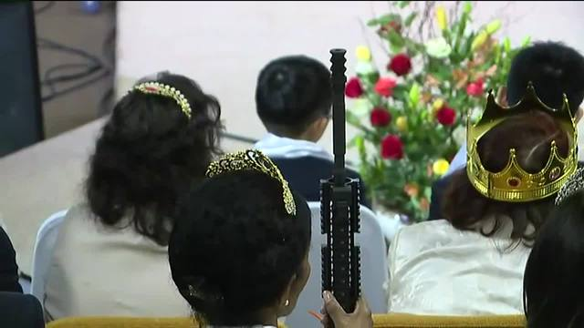 Couples clutching AR-15 rifles hold commitment ceremony at Pennsylvania church