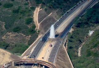 Genesee Ave geyser sends water, debris into air