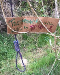 Threatening warning posted at homeless camp