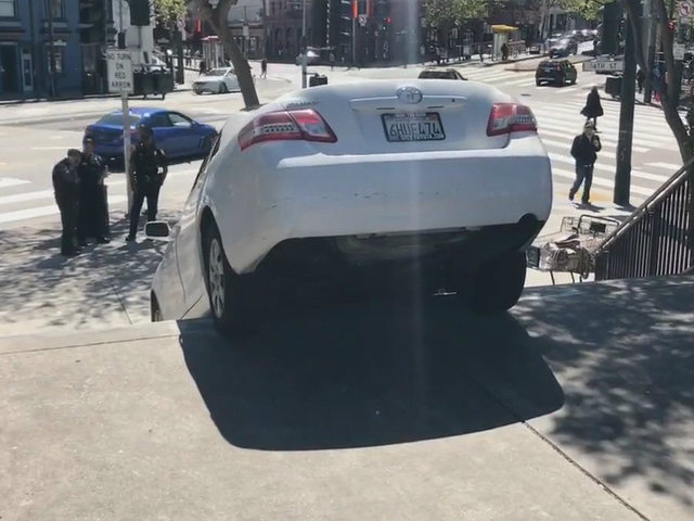 Uber driver attempts to drive down stairs in San Francisco, gets stuck