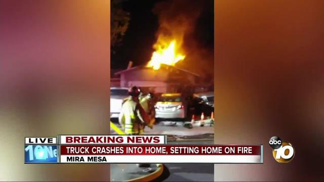 SUV backs into home- starts fire in Mira Mesa