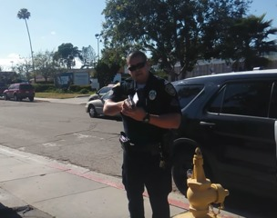 Video shows officer draw gun on man with camera