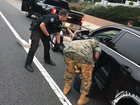 Officers pay to have Marine's car towed to base