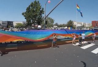 Man drives through barricade during Pride