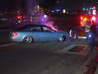 Naked woman runs out of car after median crash