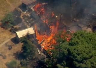 Fire burns down home, brush in Ramona