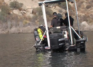 Divers and dogs search reservoir for girl