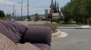 Caught on video: man leaves couch in street
