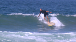 Heart attack can't keep surfer off the waves