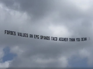 Local restaurant owner trolls Spanos with banner