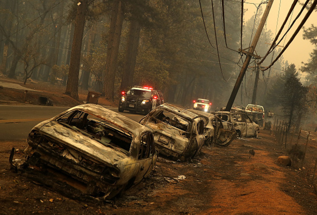 Image result for images of burned cars left in the middle of fire on Nov. 11, 2018