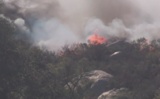 Brush fire ignites in Ramona amid high winds
