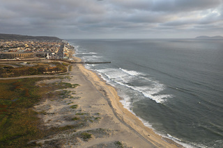 Aerial View: Border fence at the beach